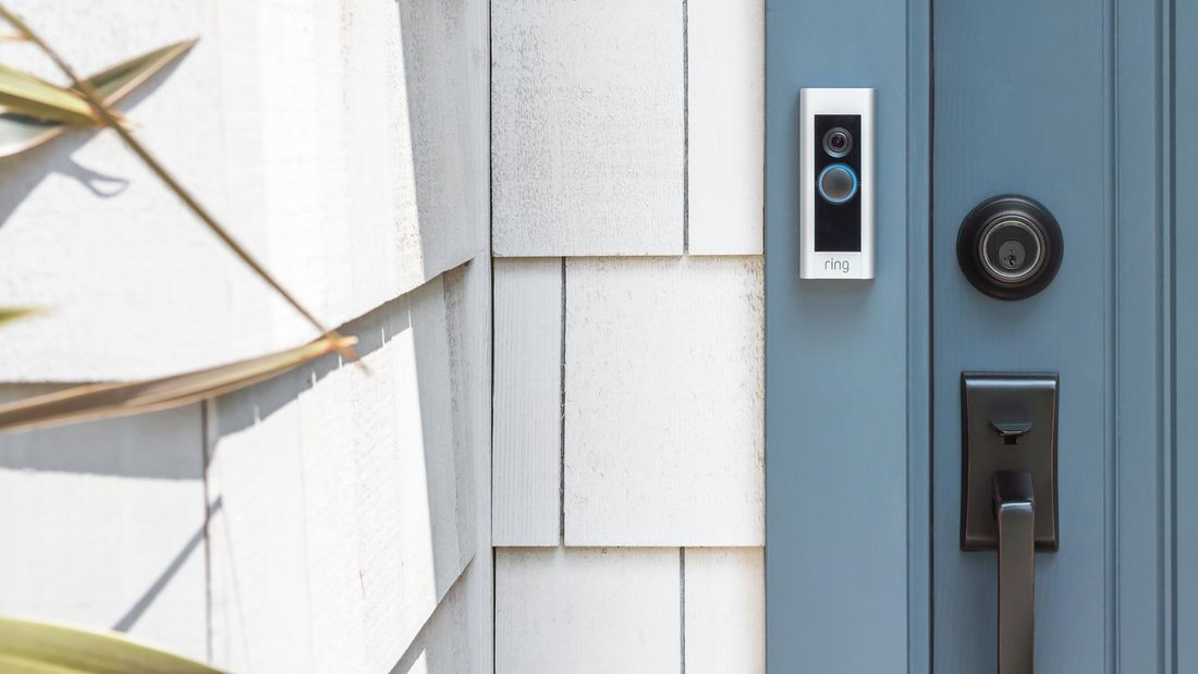 The front of a house with a blue door and doorbell