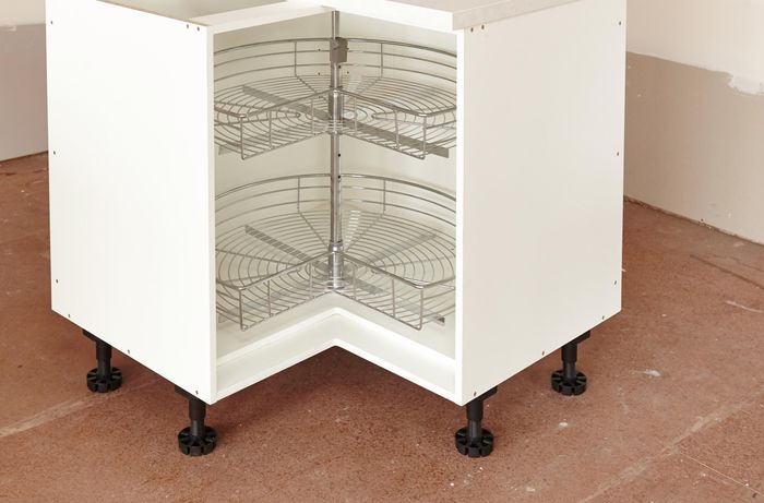 A corner cabinet unit with a two-tier rotating rack inside