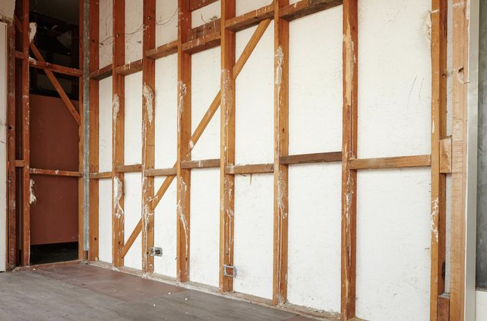 A stud wall frame with insulation removed