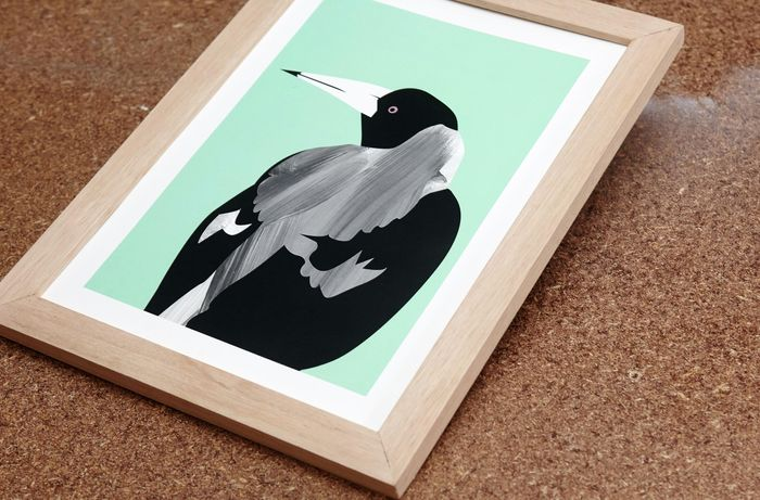 A painted picture of a vicious magpie, mounted in a home-made wooden picture frame