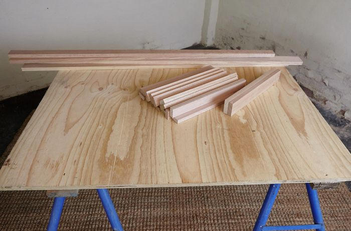 Pieces of timber laid out on a workbench