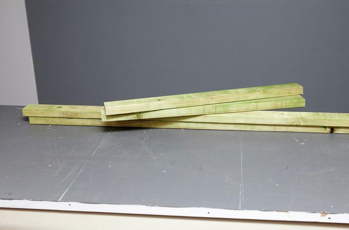 Several planks of wood in a pile