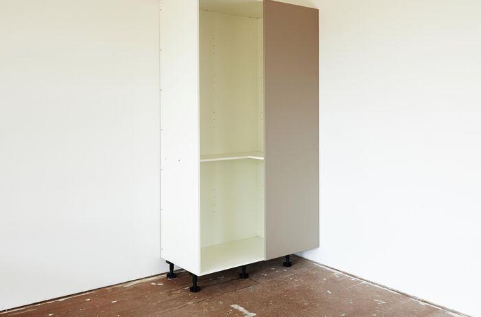 Completed white blind corner pantry in corner of room