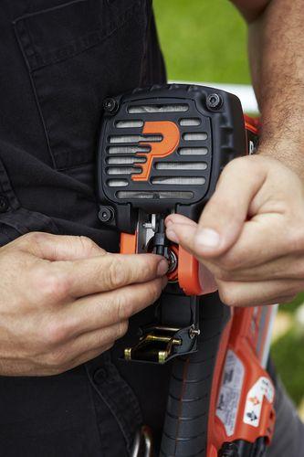 Person adjusting settings of nail gun