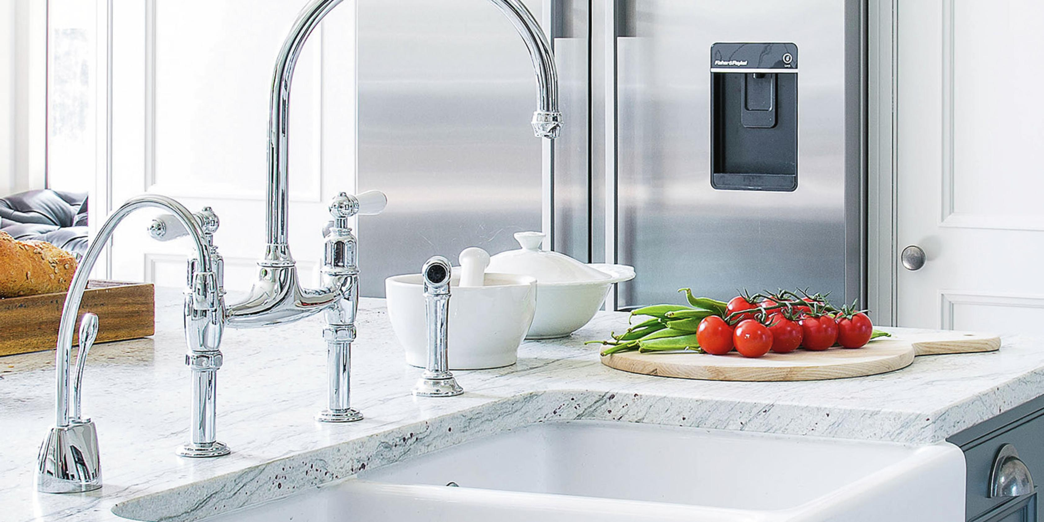 Double under-mounted sink with marble benchtops and stainless steel taps