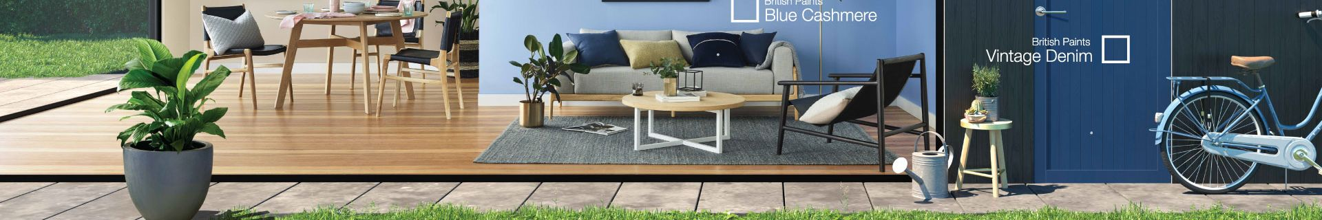 Living room with timber flooring, blue walls, couch and coffee table. Walls are painted in British Paints Blue Cashmere, Ace of Spades and Vintage Denim.