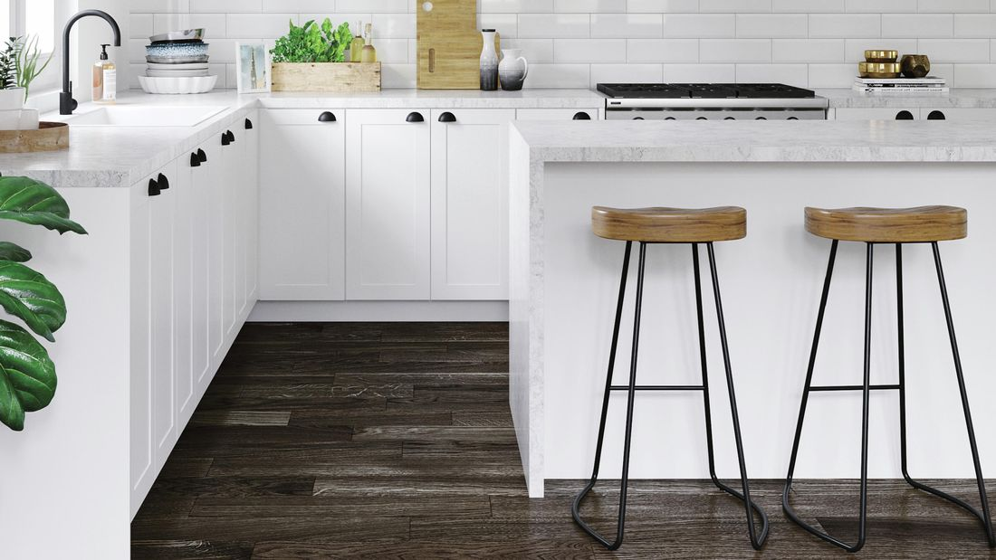 Kitchen with white benchtops, marble benchtop and white tile splashback.