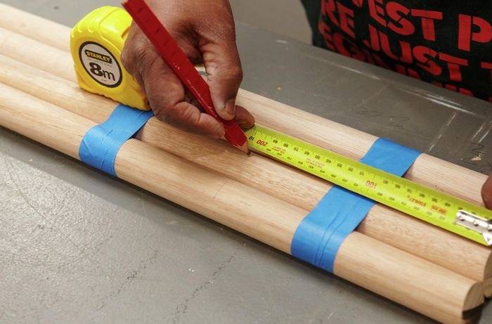 Bar stool legs being measured together
