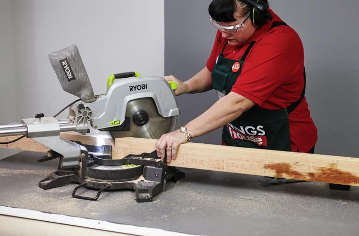 A piece of timber being cut at 45 degrees for a corner piece