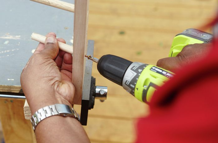 Person drilling nailing to join pieces of timber together