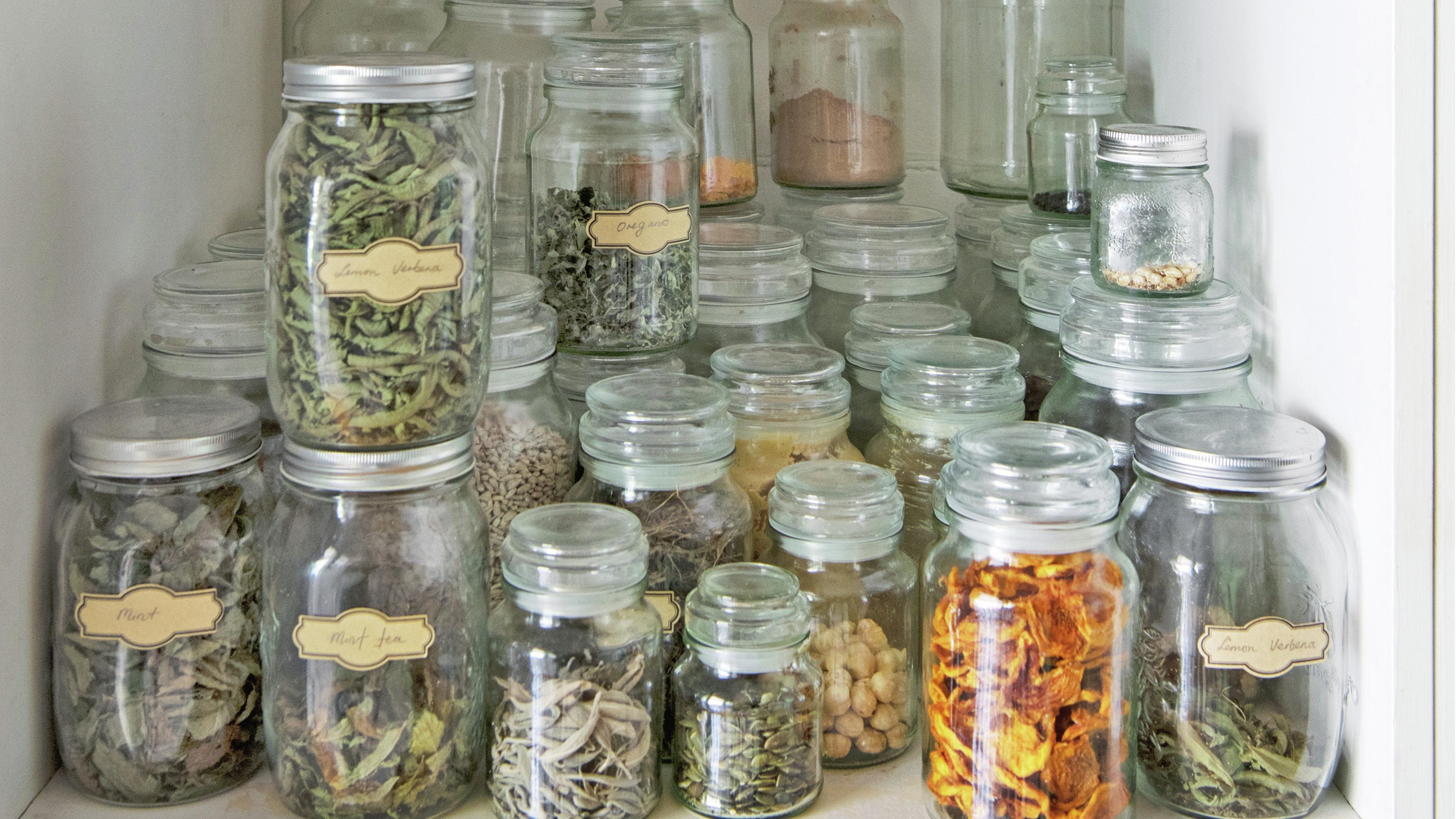 Assorted jars in a pantry.