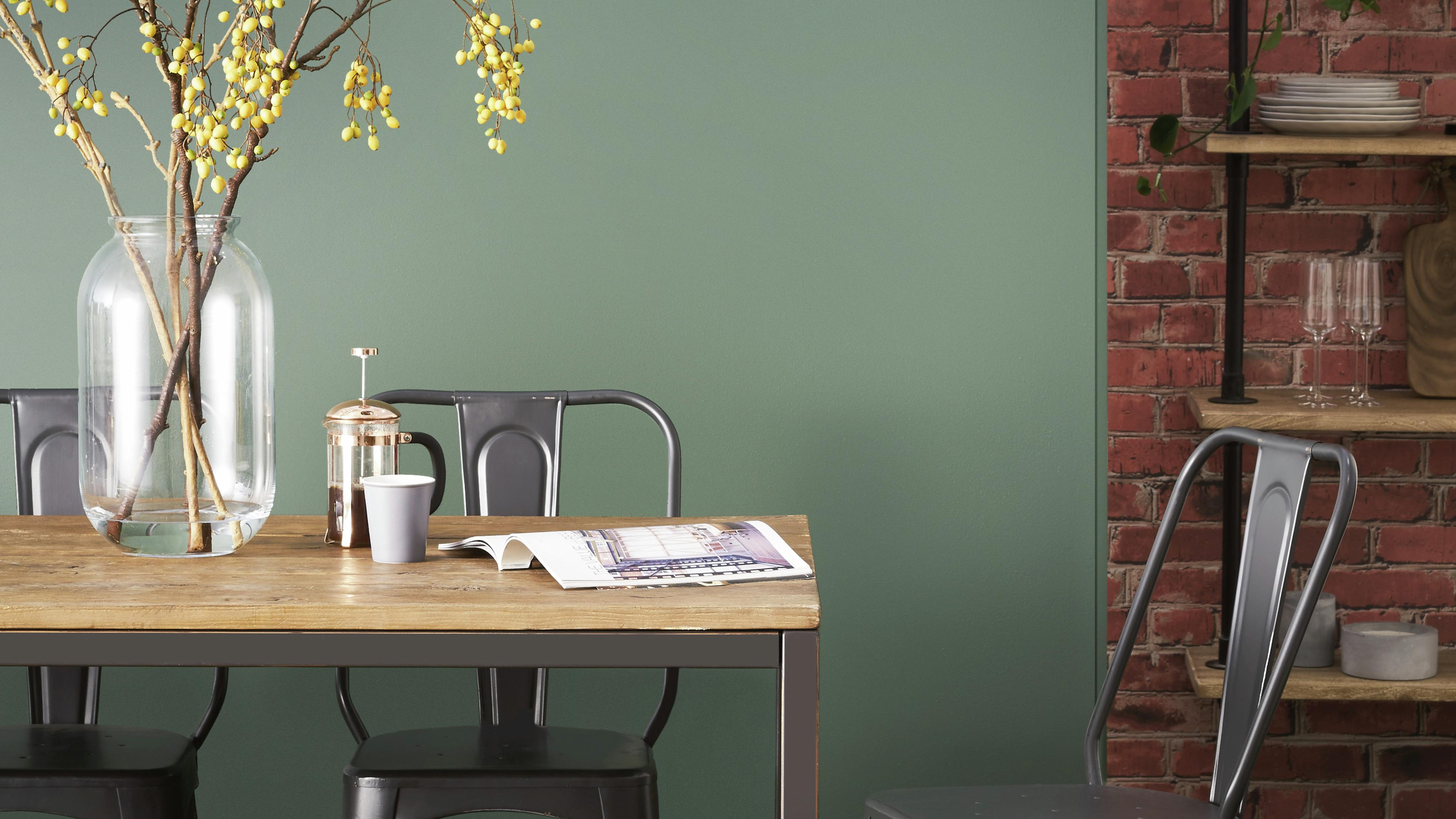 Dining room with green painted wall.