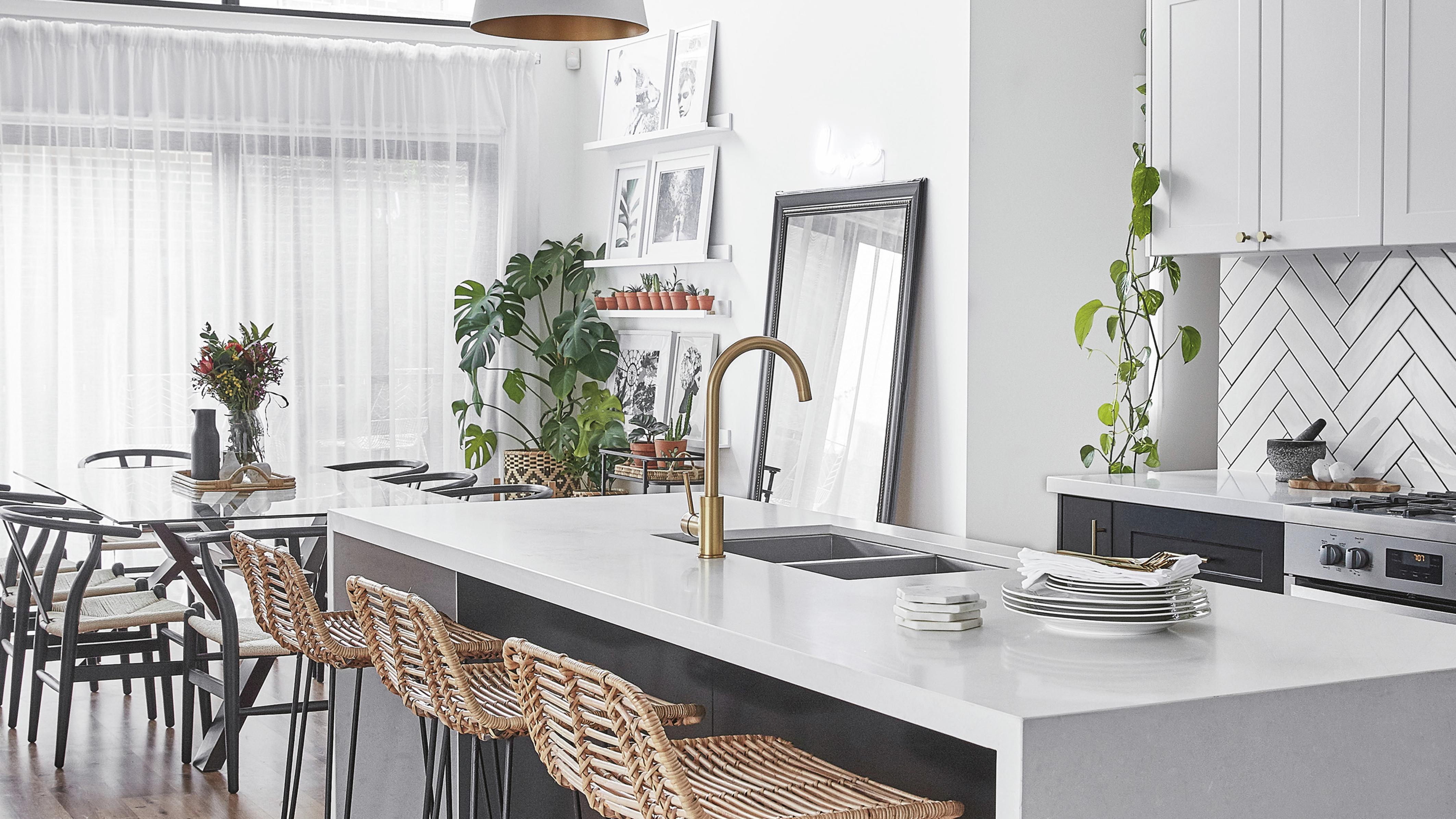 Modern kitchen with white laminate kitchen benchtop featured.