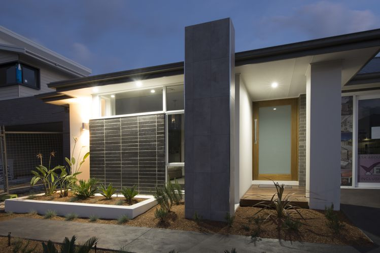Front of a modern home, with timber and smoked glass front door