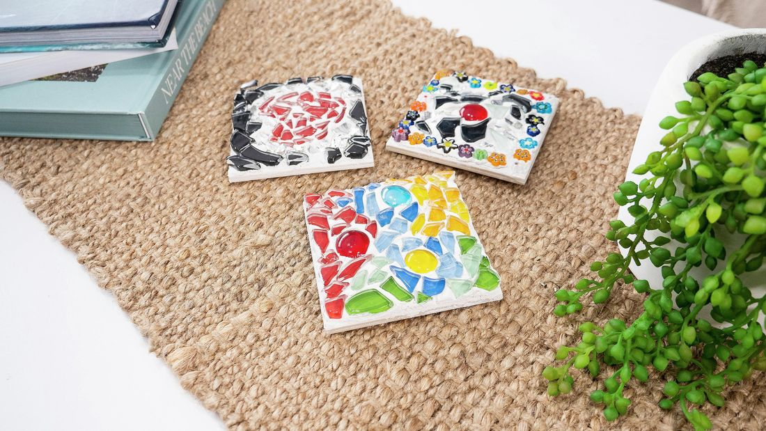 Three pieces of mosaic tile art