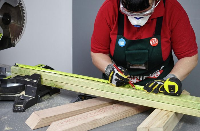 Two wooden lengths being measured and marked for cutting to size
