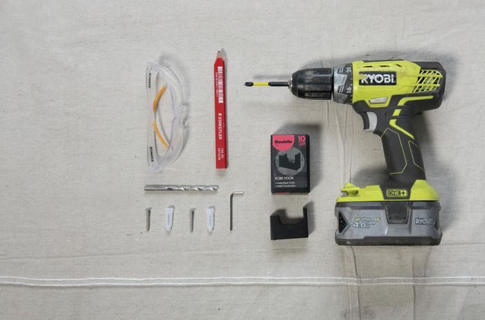 All the tools required to put a hook in a wall