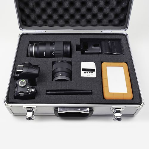 Case containing camera and accessories in fitted foam base