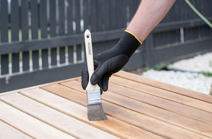Using a paintbrush apply the furniture oil.
