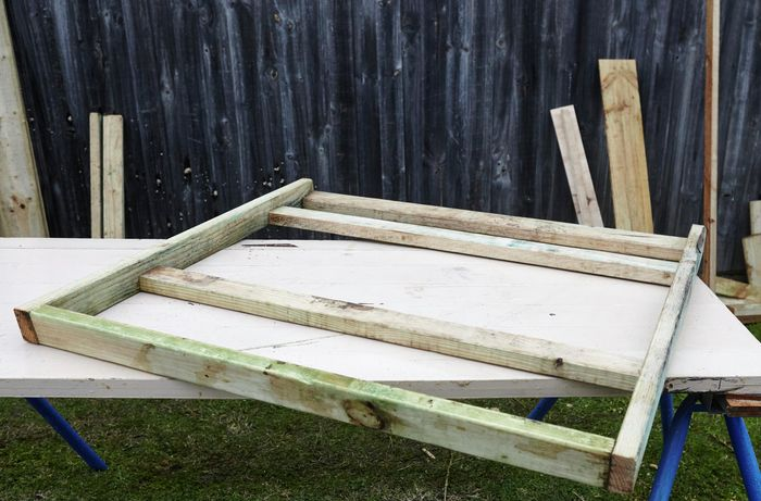 A frame for a chicken coop assembled out of timber