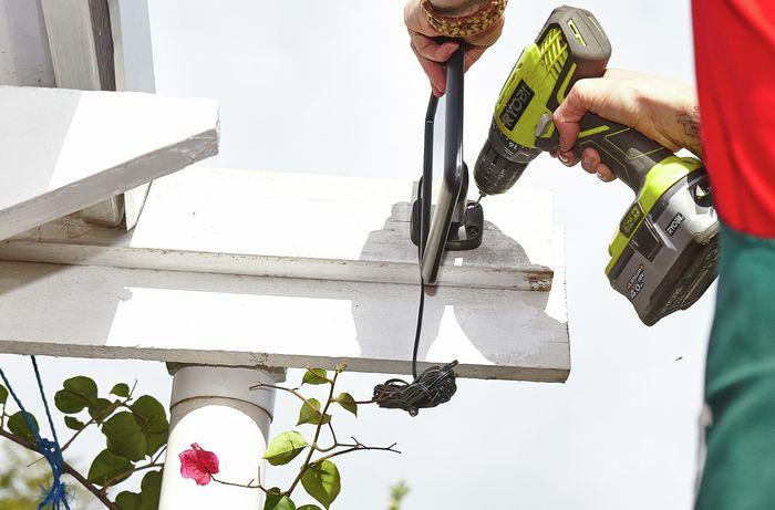 DIY Step Image - How to install a solar sensor light . Blob storage upload.