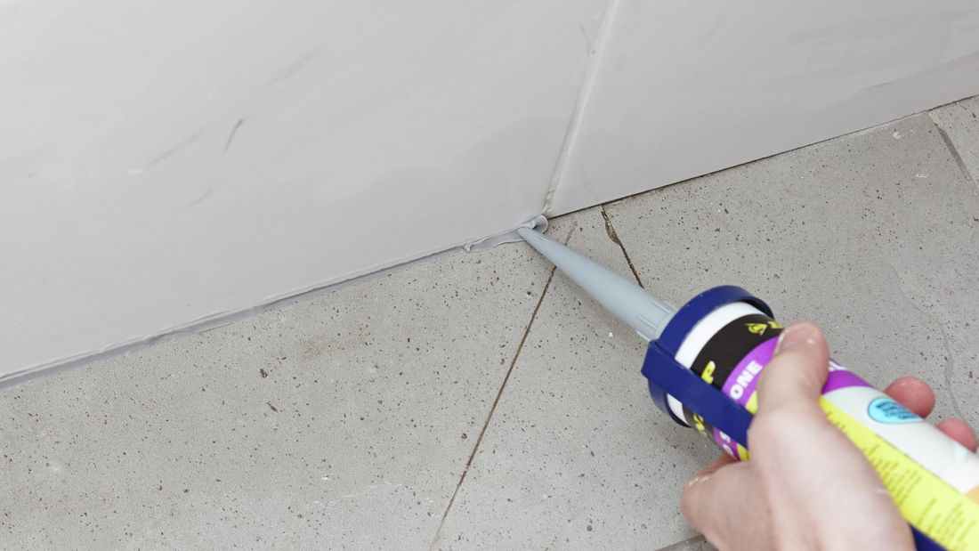 DIY Step Image - How to apply bathroom sealant . Blob storage upload.