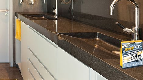 Kitchen benchtop with molded sinks and stainless steel tapware