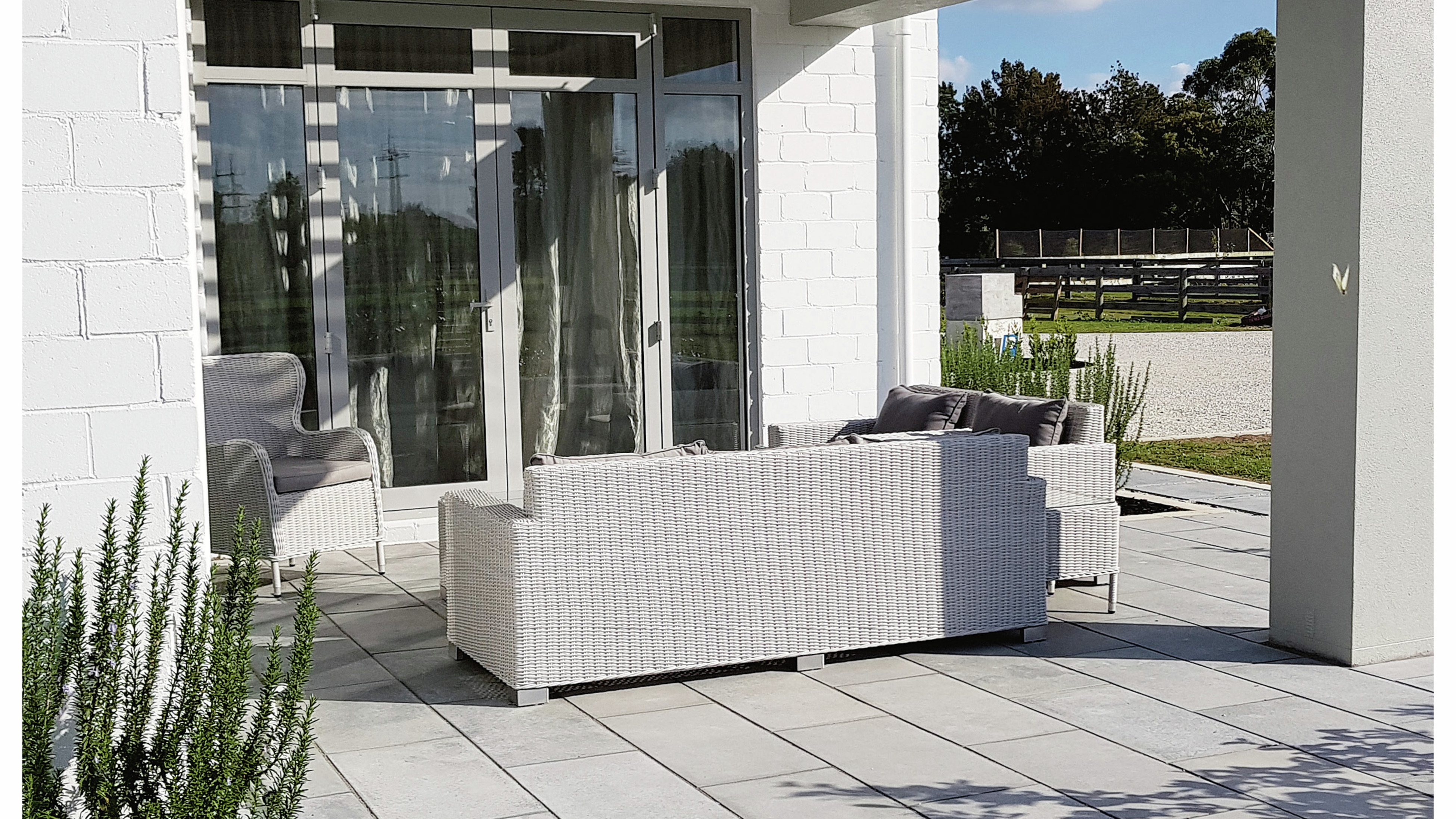 Paved outdoor area with outdoor furniture.