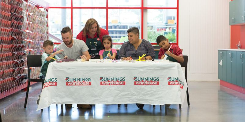 Bunnings team member and families at a kids workshop in-store.