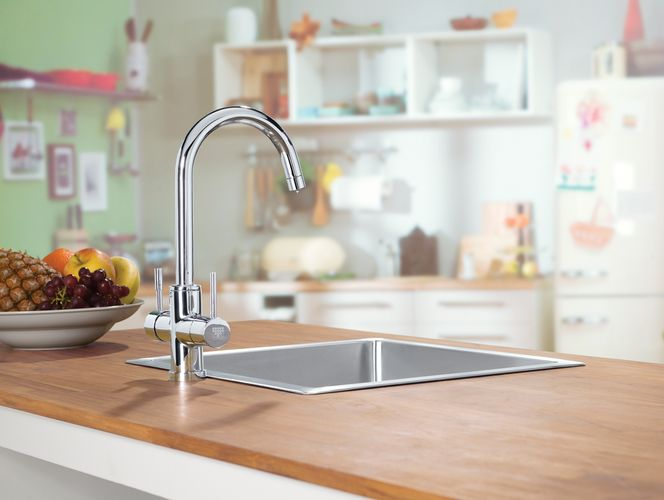 Kitchen benchtop with stainless steel sink and tapware