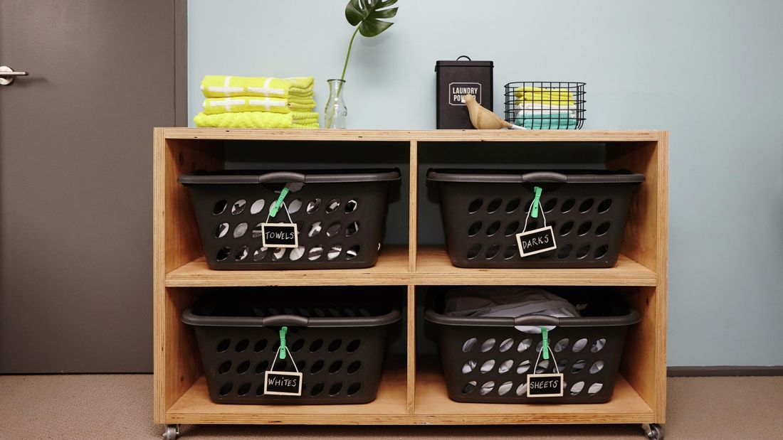 A completed laundry basket dresser with four marked laundry baskets