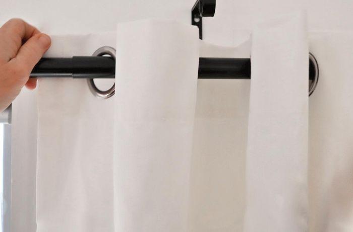 Threading a ready-made curtain through a curtain rod