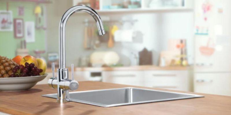 Dux representative helping customer choose hot water system.