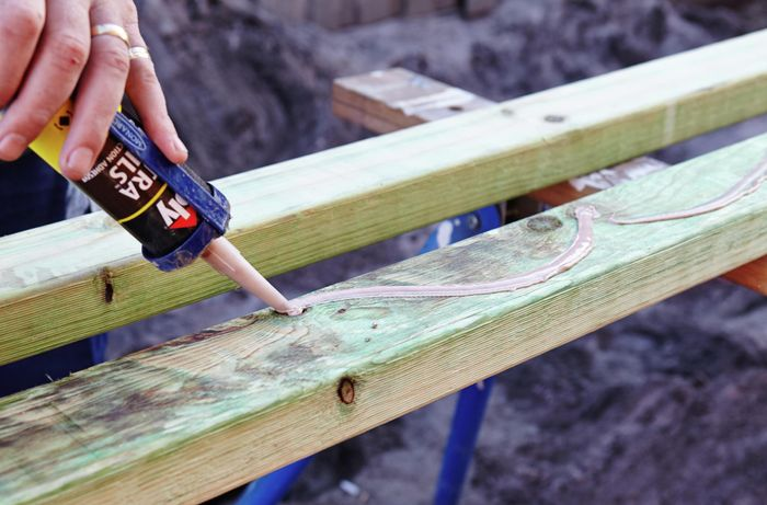 DIY Step Image - How to install bearers and stumps for a deck . Blob storage upload.