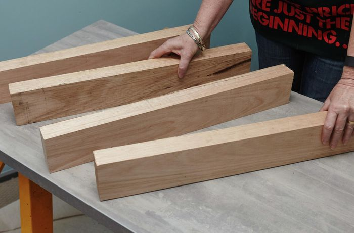 Four cut lengths of timber on a bench