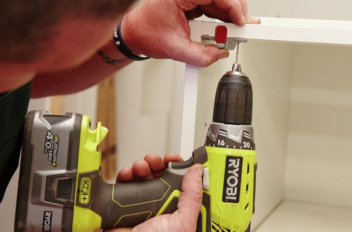DIY Step Image - How to install push-to-open hinges on your cupboards . Blob storage upload.