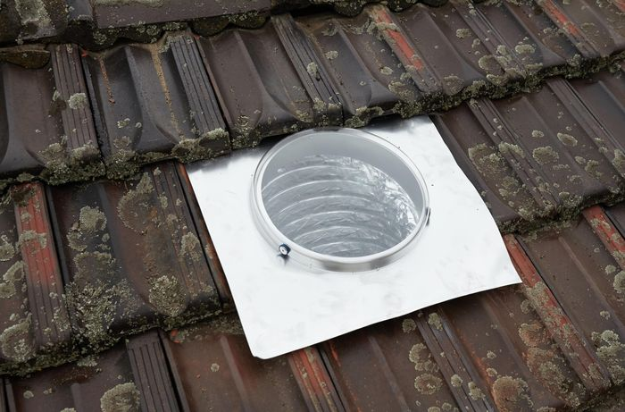 A skylight template and flashing laid out on a roof for positioning purposes