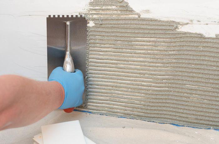 Add adhesive glue to wall