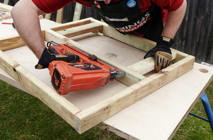 A timber frame for a chicken coop being constructed using a nail gun