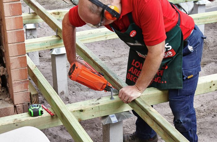 DIY Step Image - How to install joists for a deck . Blob storage upload.