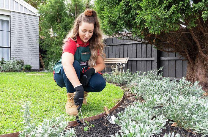 Person digging up their garden.