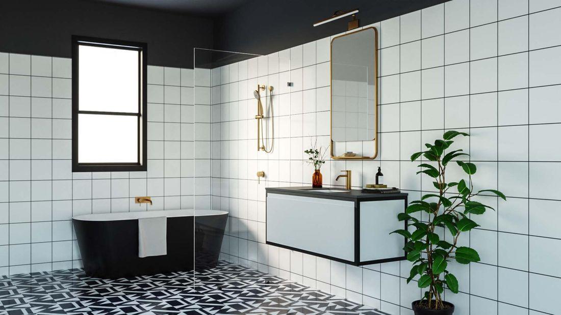 Black and white bathroom with black bath, white tiles, white and black bath with green plant in the corner