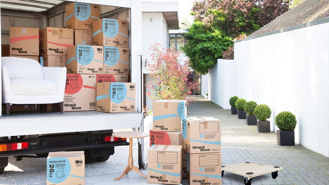 Removal truck full of packing boxes and furniture