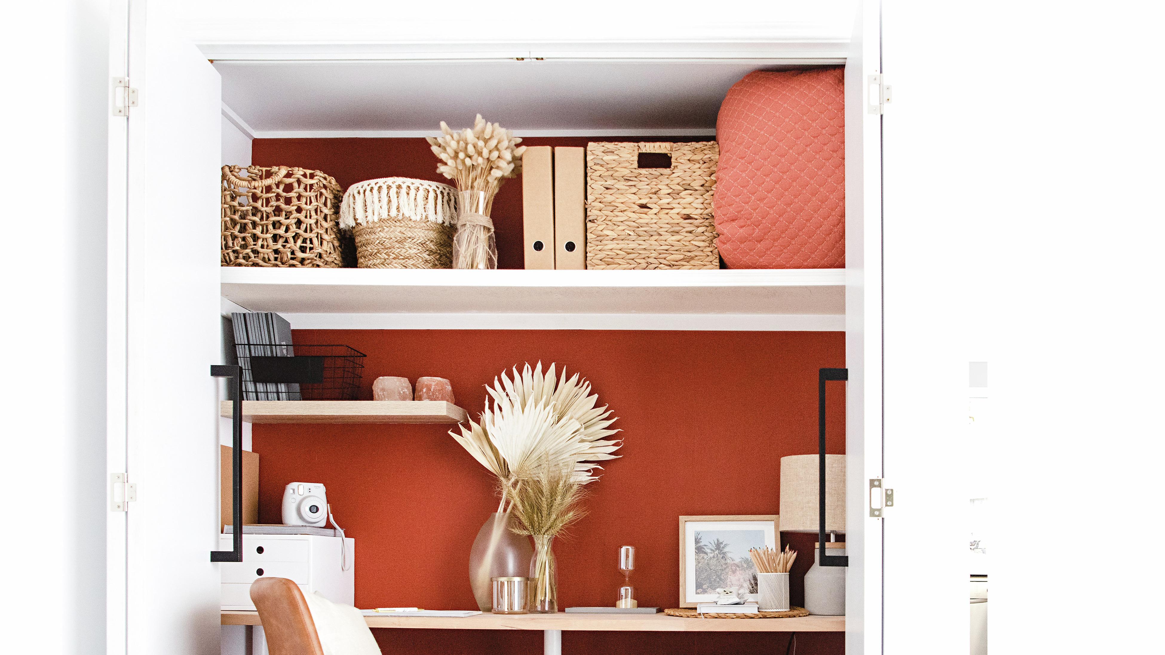 A desk that has been built into a closet.