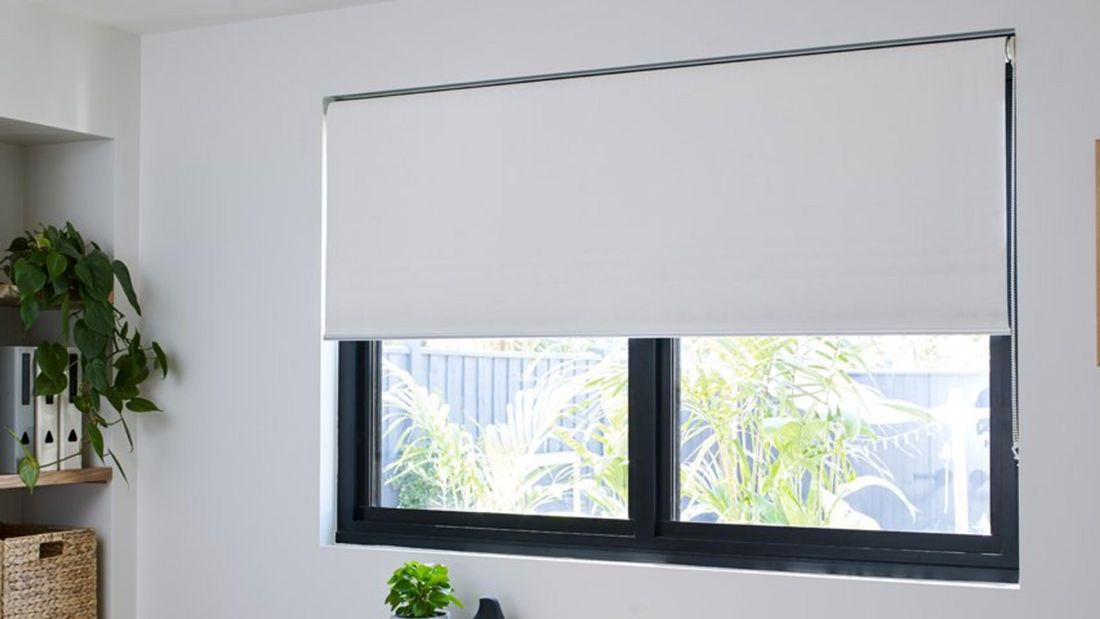 White Riva blinds in a home office interior.