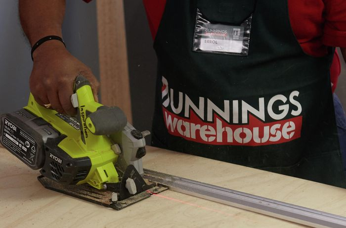 Person cutting ply with circular saw