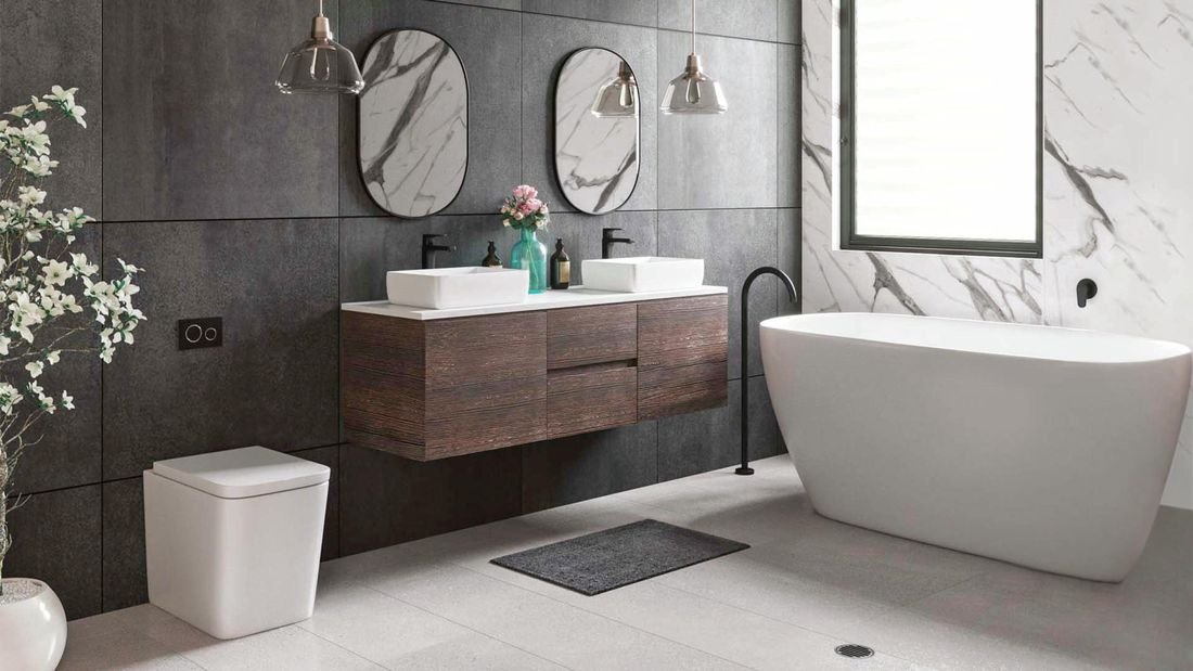 contemporary bathroom with freestanding bath, timber vanity and dark tiles