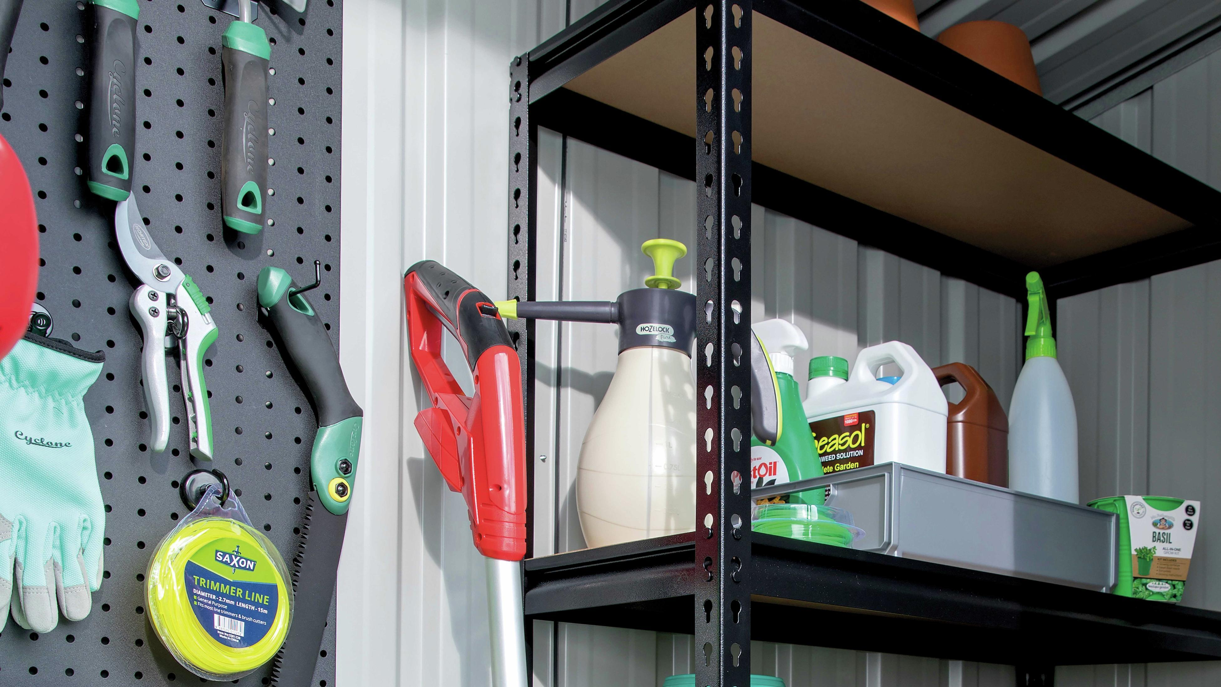 Garage shelving and peg board with garden supplies and tools