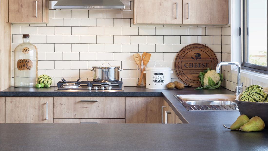White tiles in a kitchen.