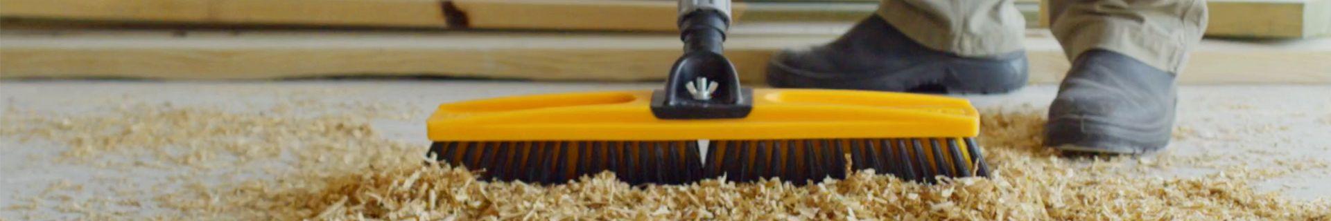 Broom sweeping sawdust.